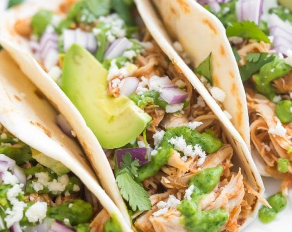 Close up of Crockpot chicken tacos with lots of toppings