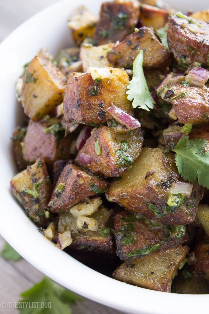This herb-roasted potato salad is absolutely delicious: crispy roasted potatoes, heady dried herbs, and a rich and creamy sauce with fresh herbs and minced red onions. Packed full of flavor, this herb-roasted potato salad is destined to become a favorite, both with the family and with your guests! This herb-roasted potato salad is also paleo, Whole30-compliant, and vegan friendly. Simply put, it's the best herb-roasted potato salad out there.