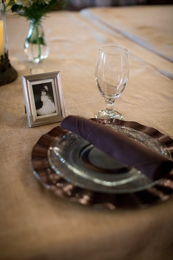 We wrangled up old pictures of everyone at the family tables and used those as place markers.. they were so surprised!