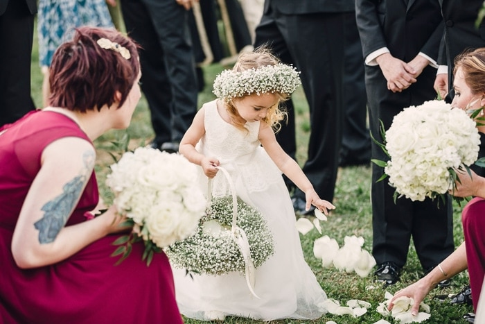 After the ceremony our flower girl decided she'd cover the ground with her flower petals.. and with a frenzy! How cute is she?!