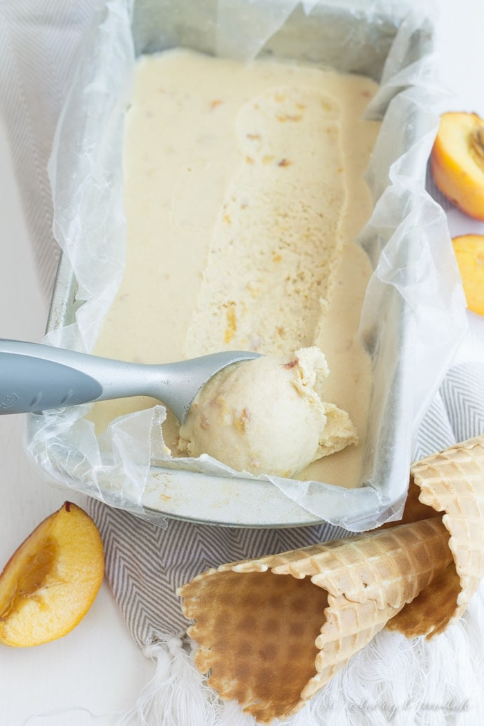 Vegan Peach Ice Cream. 7 ingredients, no refined sugars, no gluten. Just tons of peaches and coconut milk and summery goodness!