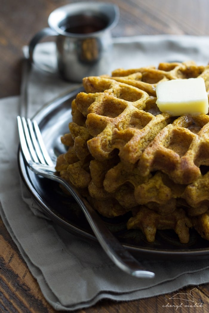 Tender, spiced vegan pumpkin waffles. Perfect for fall mornings