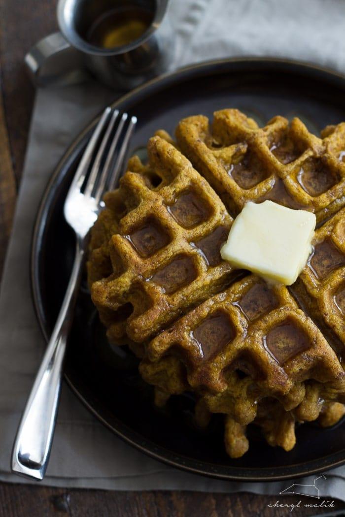 Tender, spiced vegan pumpkin waffles. Perfect for fall mornings