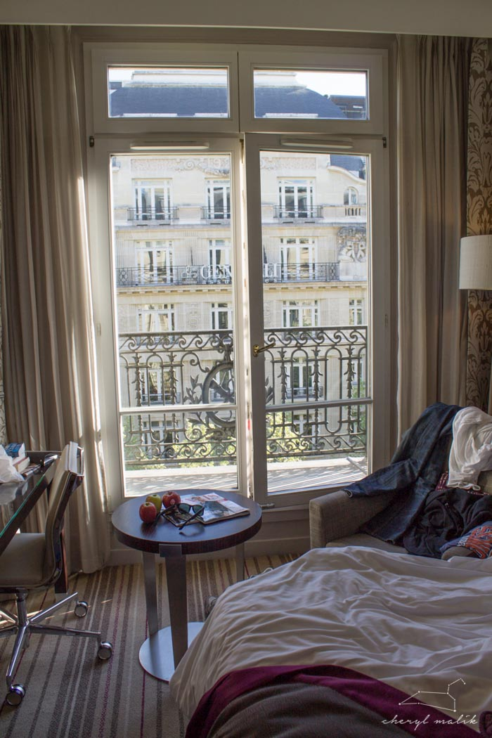 "Our very first room, in Paris! This was our ""splurge"" stay, so we had to take a photo. This was a welcome sight after a rushed flight after the wedding and a long, LONG voyage"