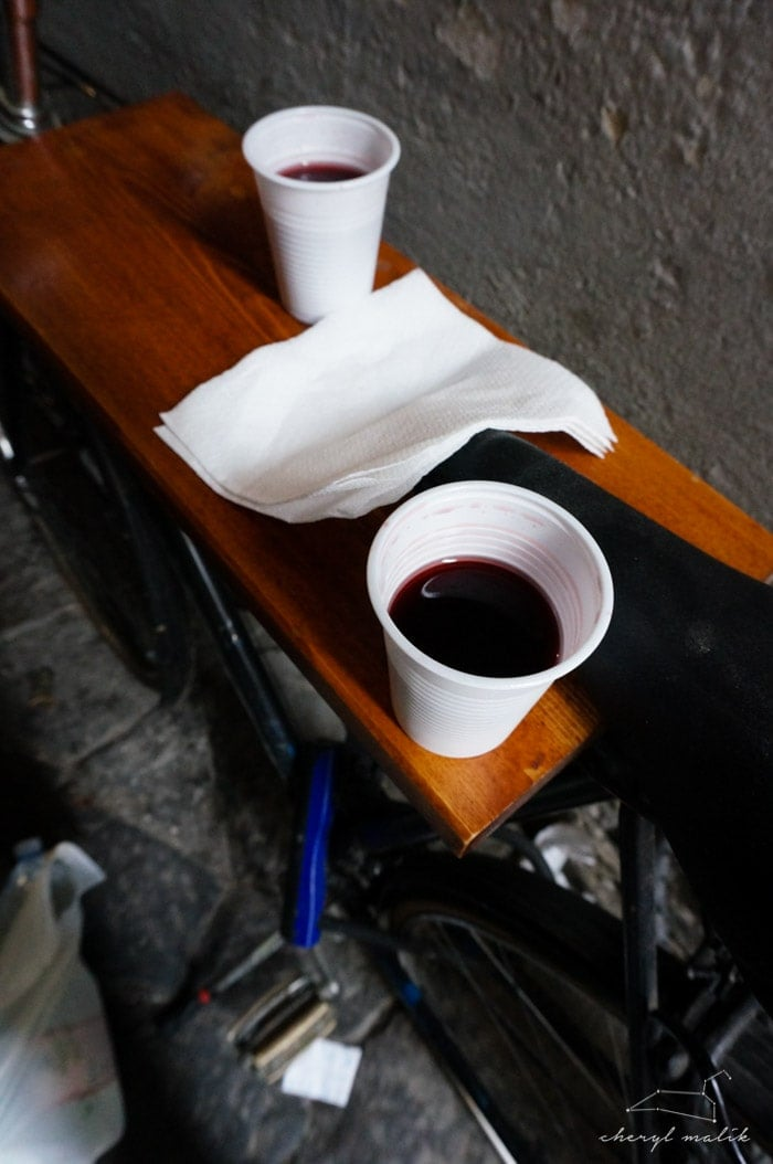 And then we found this OTHER little sandwich shop that was more like a window in an alleyway... and they served more wine in more plastic dentist cups and they made tables out of the bicycles..
