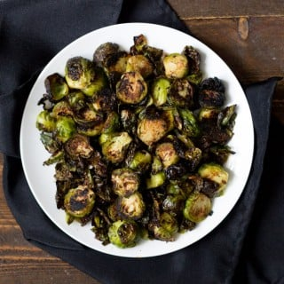 Crispy miso roasted brussel sprouts - in a miso, white wine, and butter sauce, these brussel sprouts are crazy good and so simple! Perfect for Thanksgiving