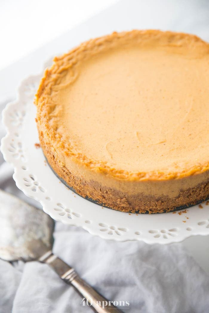 Vegan pumpkin cheesecake on a cake stand
