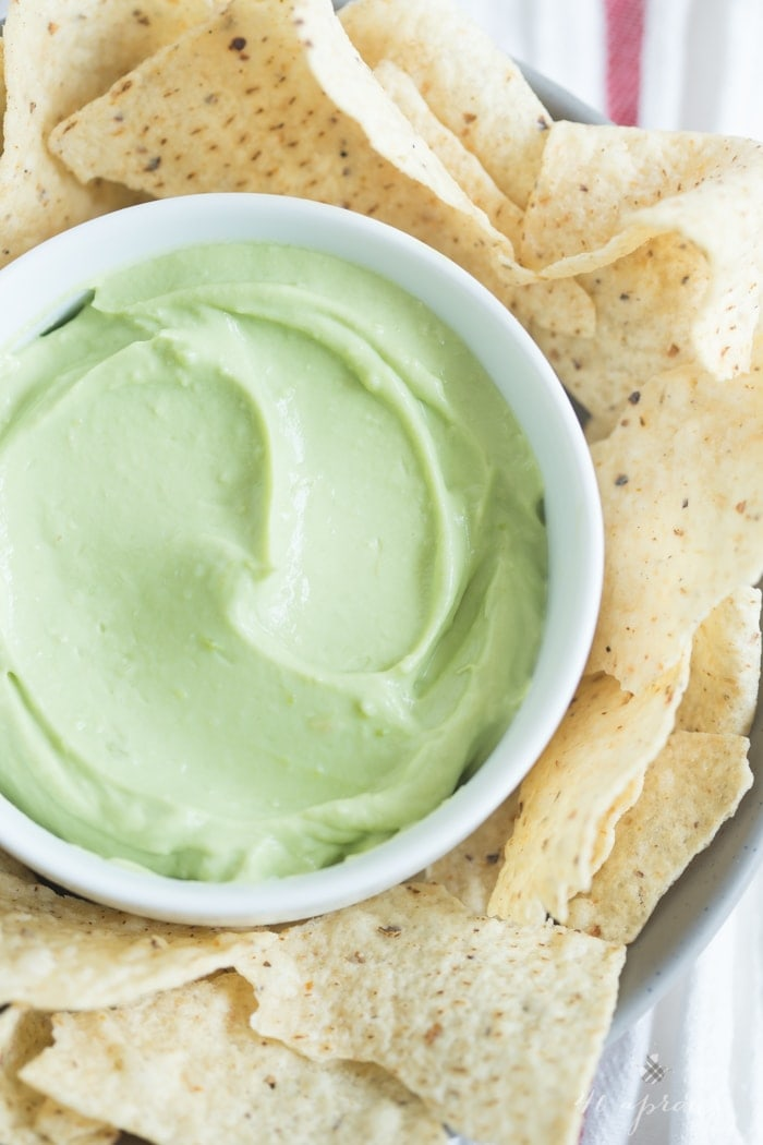 A tart, rich, and bright avocado dip that takes minutes to prepare and is incredibly versatile. Greek yogurt for protein and general ease and deliciousness! // 40 Aprons