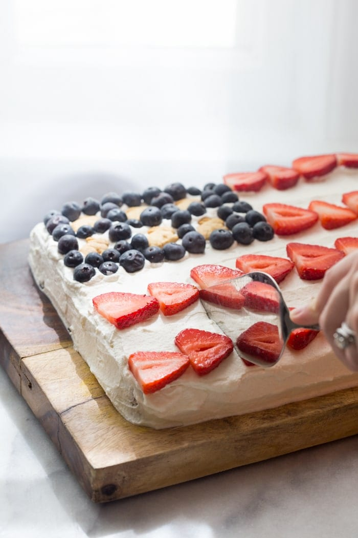 Flag Cake with Whipped Cream Frosting & Bunny Grahams // Rich yellow cake with a whipped cream-cream cheese frosting, finished with fresh fruit and sweet Bunny Grahams. Happy 4th of July, you beautiful patriot, you.