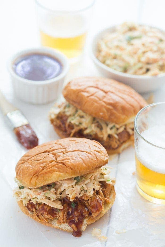 Crockpot BBQ Chicken Sandwiches - easy and perfectly tender, flavorful, and smoky, these are new standbys in our meal plan! // 40 Aprons