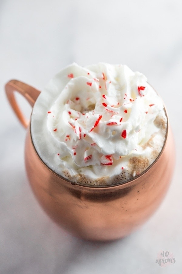 Spiked peppermint hot chocolate. So rich and creamy with the perfect boozy peppermint kick.. truly a merry Christmas! // 40 Aprons