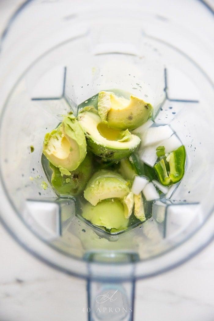 Avocado salsa ingredients in a blender