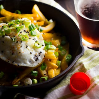 Japanese curry fries. Definition of epic. Rich, spiced Japanese curry sauce smothers crispy fries, topped with an egg over easy. Mama. // 40 Aprons
