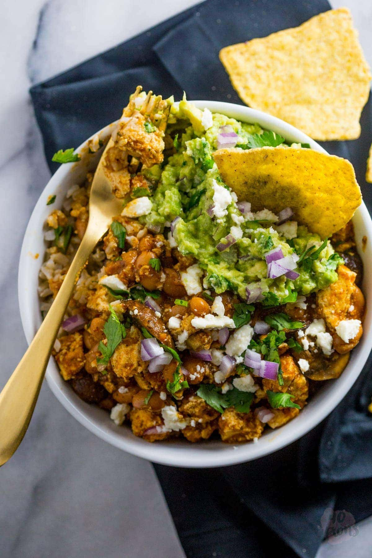 Tofu sofritas bowl - spicy, smoky, and totally vegetarian (and vegan!). You won't miss the meat. at. all. Tofu for tofu haters! // 40 Aprons