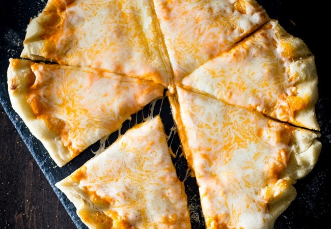 Perfect grilled pizza. So easy, quick, and delicious. Perfectly crispy shell, tender and chewy inside. // 40 Aprons