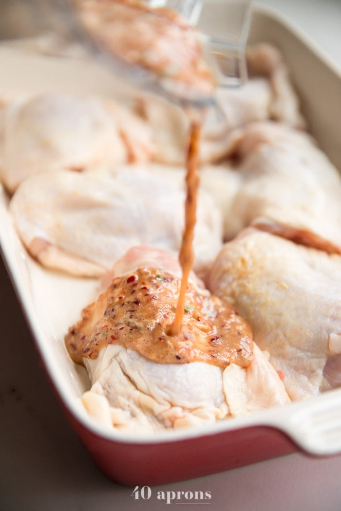 Pour marinade over chicken