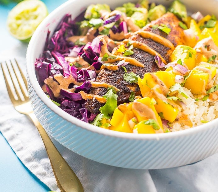 These Whole30 fish taco bowls with mango salsa and chipotle aioli make an absolutely wonderful Whole30 dinner. Loaded with guacamole, mango salsa, red cabbage slaw, coconut-lime cauliflower rice, and spicy chipotle aioli, I promise this will become your favorite paleo fish recipe or Whole30 fish recipe. Pinky promise! This Whole30 fish taco bowls recipe is gluten-free, dairy-free, grain-free, and sugar-free. Nothin' fishy about it (SORRY!).