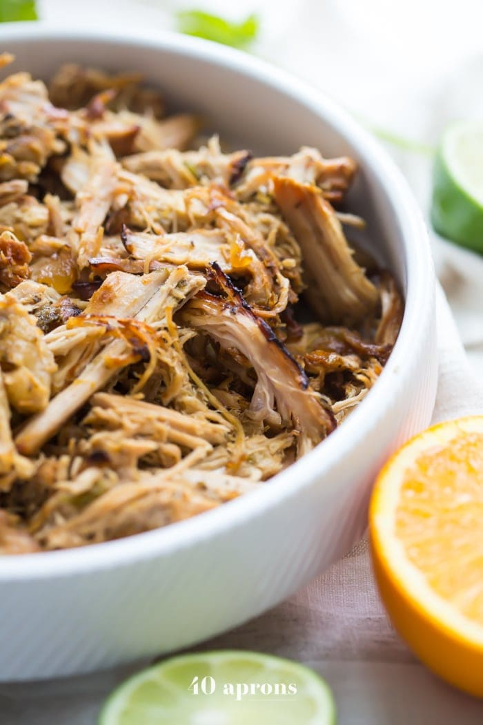 Paleo carnitas made from pork tenderloin in the Crockpot. These paleo carnitas are made with pork tenderloin in the Crockpot for a super easy Whole30 dinner. Pork tenderloin makes these paleo carnitas super budget-friendly, and they're full of flavor, making them perfect for a Chipotle copycat Whole30 carnitas bowl like you'd get at Chipotle!