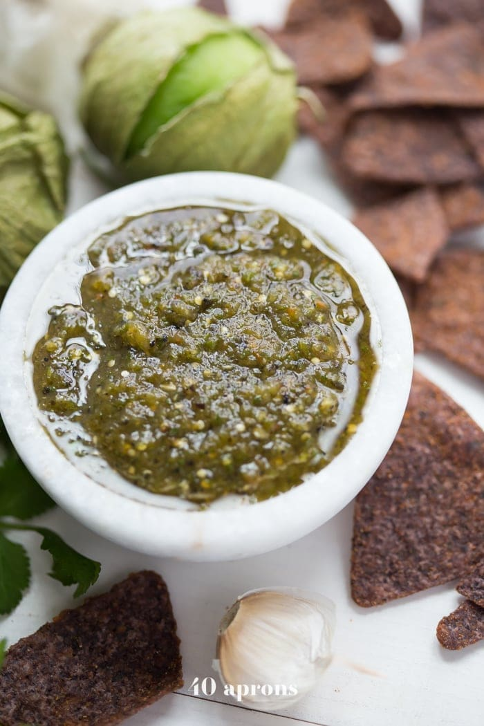 "This roasted salsa verde is full of flavor and is a fantastic Whole30 salsa for your warm weather Whole30. Packed with roasted tomatillos, jalapeño, poblano pepper, and tomato, this garlicky Whole30 salsa will become your new favorite salsa verde, I pinky promise. Of course, it's not just a Whole30 salsa - it's a ""for everybody all the time on everything"" salsa, too. Just saying!"