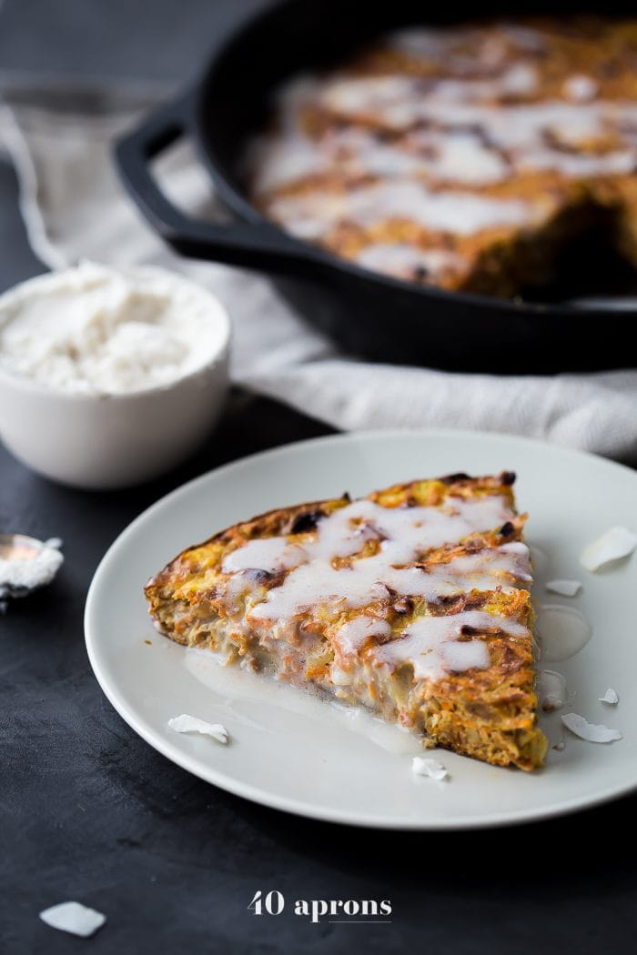 This carrot cake paleo breakfast bake is like eating carrot cake for breakfast! With pineapple, golden raisins, coconut, cinnamon, walnuts, and a paleo cream cheese glaze, this paleo breakfast bake is easy but delicious. Destined to become a regular on your paleo breakfast bake roster!