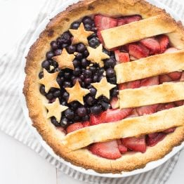 This paleo American flag pie is the absolute perfect paleo 4th of July dessert. Full of fresh strawberries and blueberries with a crunchy crust, it's a stellar paleo pie that's just stunning. Is there a better paleo pie for the ultimate paleo 4th of July dessert table? I think not!