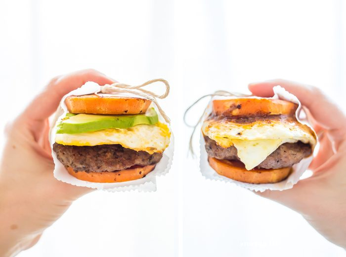 These Whole30 breakfast sandwiches are easy to make and insanely good. Buttery sweet potato buns layered with Whole30 breakfast sausage, fried egg, and avocado or quick Whole30 chipotle aioli, they're about to be your favorite Whole30 breakfast.