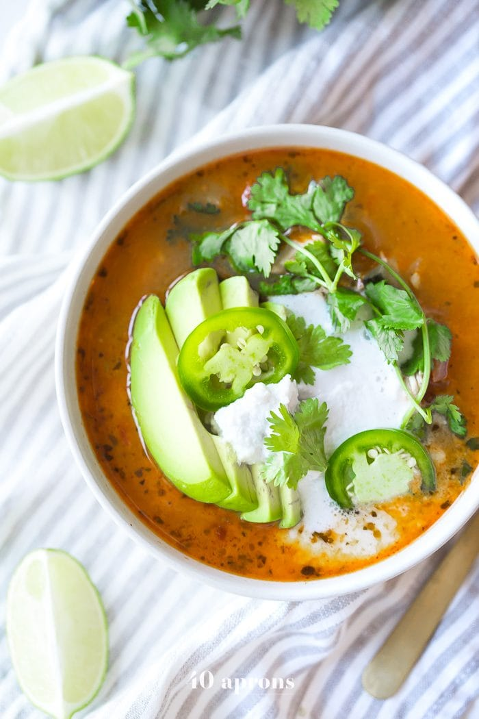 This Whole30 Instant Pot chicken tortilla-less soup is full of flavor and so easy to make, thanks to RO*TEL! A delicious Whole30 soup, this paleo chicken tortilla soup comes together quickly and doesn't heat up the kitchen. Perfect for an anytime fiesta! You'll love this Whole30 Instant Pot recipe, and it might just become your new favorite Whole30 soup!