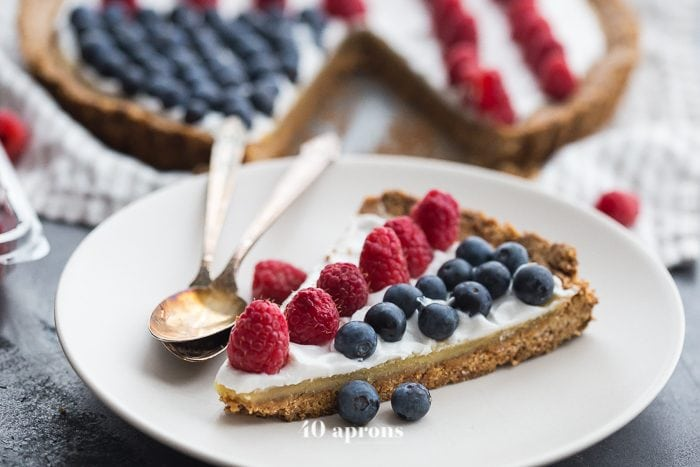 This paleo flag fruit tart is Fourth of July dessert perfection. With a coconut oil shortbread crust, rich almond frangiapane filling, and topped with cool coconut cream and fresh fruit, you've got your paleo Fourth of July dessert covered. Why make a paleo 4th of July cake when you can make a tart delicious enough to beat all other paleo 4th of July desserts?! U-S-A! U-S-A!