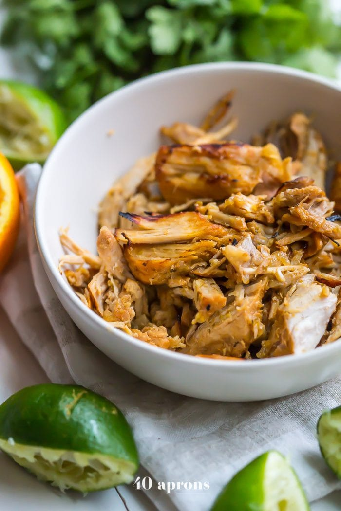 These perfect paleo Instant Pot carnitas are tender, flavorful, and juicy, made in about 30 minutes. A perfect Whole30 dinner, these Whole30 carnitas are the best carnitas I've ever had... and that's saying something. Instant Pot carnitas are so freaking good, easy, and quick, they might just become your new go-to during the week!