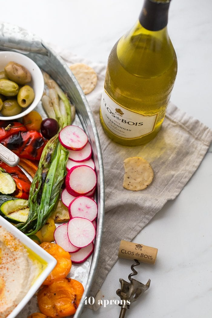 This healthy Greek appetizer platter is perfect for summer entertaining, loaded with healthy make-ahead appetizers you can customize to your own tastes. My healthy grilled Greek appetizer platter includes Mediterranean dips and spreads, grilled veggies, fruits, and halloumi, fresh fruit, nuts, and feta topped with a rich, fruity reduction. If you're doing some summer entertaining soon, this healthy Greek appetizer platter is just the thing you need!