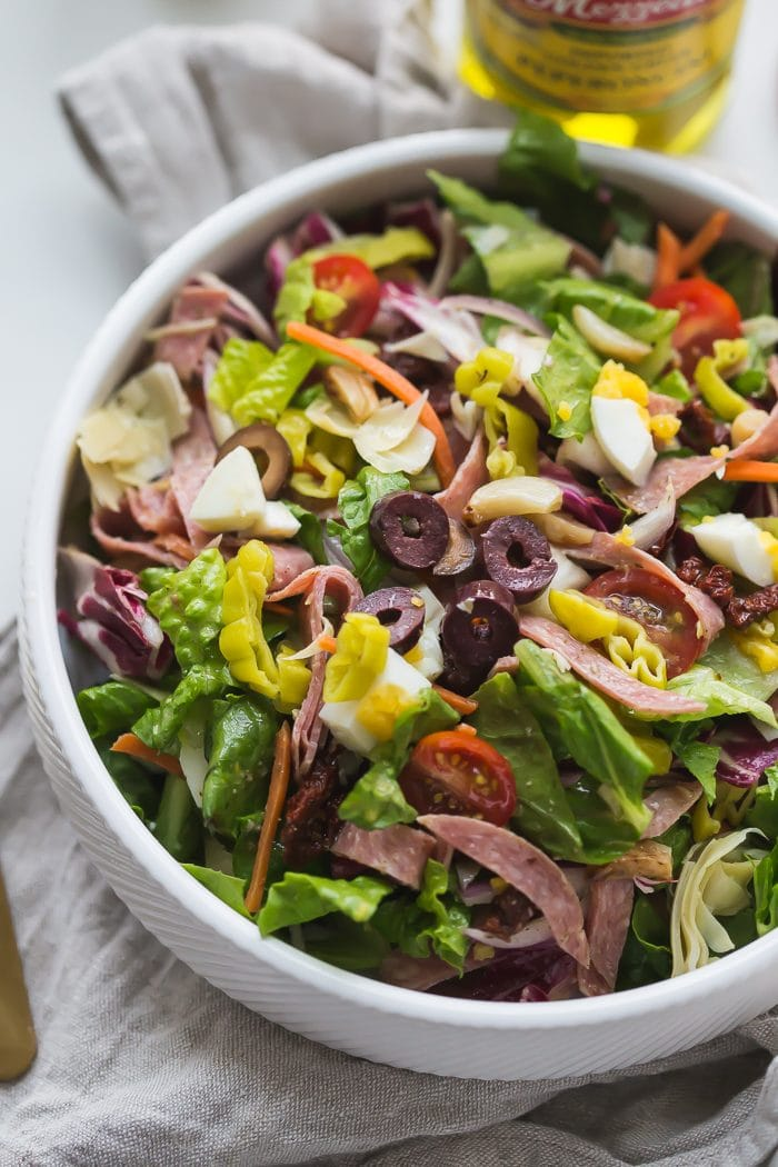 This paleo Italian salad is one of my very favorite paleo salads: loaded with radicchio, roasted garlic, olives, bright and spicy peperoncinis, salami, sun-dried tomatoes, and more. Such a great paleo dinner, paleo salad, or paleo side dish! Seriously, this paleo Italian salad will become a staple in your meal plan.