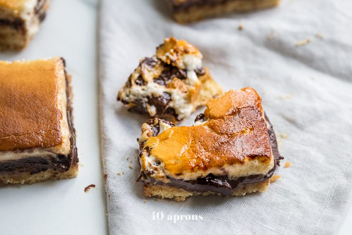 These paleo smores bars are the perfect paleo dessert this summer. A graham cracker crust, topped with chocolate and a burnt marshmallow layer, they're inspired by the classic summer treat but are grain-free, dairy-free, and refined-sugar-free. These paleo smores bars are great for entertaining!