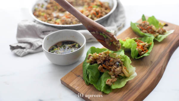Spoon mixture into lettuce cups and serve with sauce