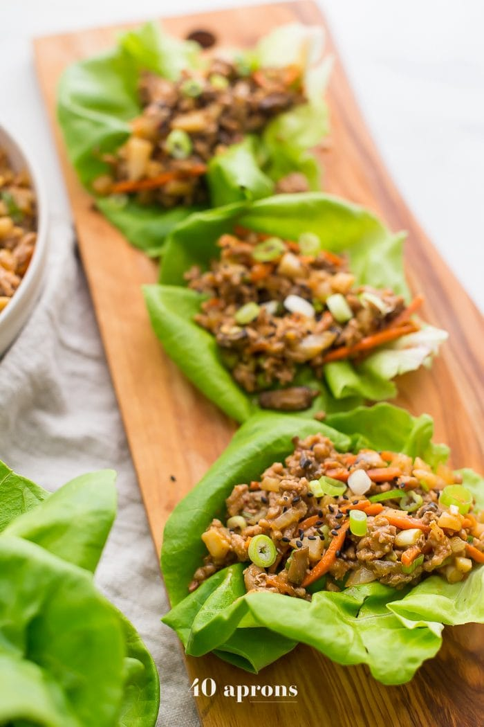 Healthy PF Changs lettuce wraps recipe on a board
