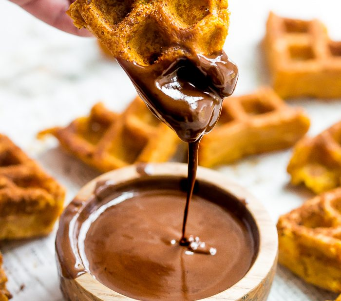 These paleo pumpkin churros with dark chocolate sauce are heavenly: loaded with fall flavor, crispy on the outside, tender on the inside, and made in the waffle iron! They're such a perfect paleo fall recipe because they're totally delicious but there's no frying necessary. These paleo pumpkin churros with dark chocolate sauce are a must make when it comes to paleo fall recipes!