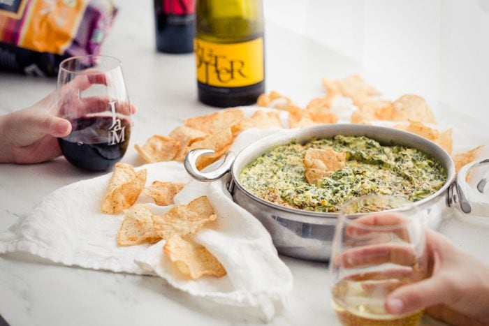 This paleo spinach artichoke dip is a healthy take on the classic appetizer. Rich and creamy, this vegan spinach artichoke dip is the perfect recipe for casual entertaining, especially in late summer and early fall. This paleo spinach artichoke dip is dairy free and goes perfectly with some paleo tortilla chips! One of my very favorite paleo appetizers, it really doesn't taste paleo!