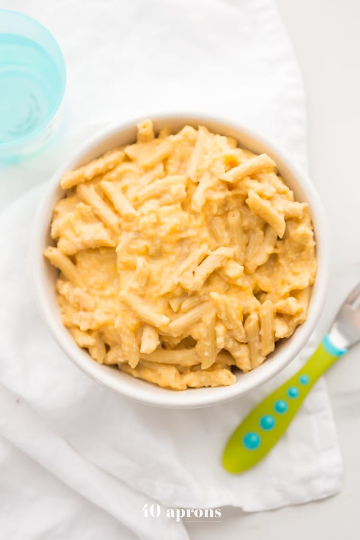 This quick hidden veggie mac and cheese comes together in only 5 minutes and gets its creaminess from veggies! The perfect toddler mac and cheese, this quick hidden veggie mac and cheese is healthier and way better than boxed! Made with frozen cauliflower rice and carrots, Barilla Ready Pasta, and a bit of cheddar cheese, this quick hidden veggie mac and cheese will become a staple in yours kids' diets.