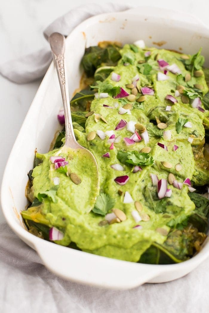 These Whole30 enchiladas are out of control! Stuffed with a roasted poblano pepper and ground pork mixture, seasoned with a, wait for it... cilantro-spinach-pepita pesto and plenty of mushrooms, they're the perfect Whole30 enchiladas recipe and they make a fantastic Whole30 dinner recipe. Topped with a rich, creamy avocado-cilantro sauce, you've got the best Whole30 enchiladas recipe ever... or maybe the best Whole30 dinner recipe ever? You decide.