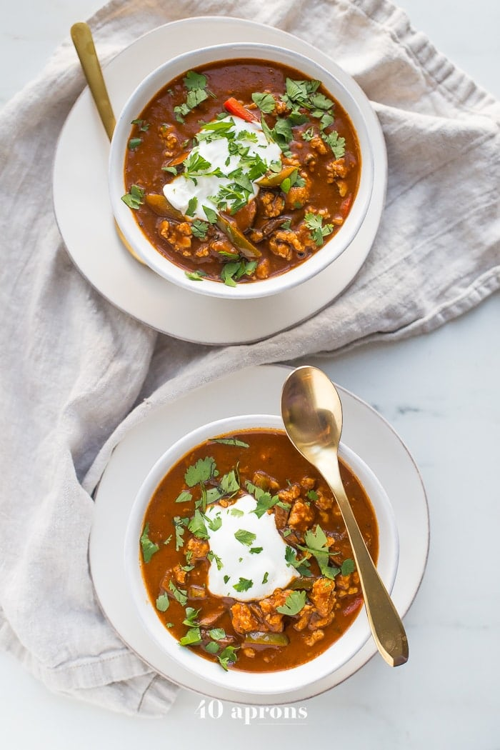 This chicken tikka masala chili is the stuff your dreams are made of. This Whole30 chili has a rich and creamy tomato sauce, with beautiful caramelized onions, garlic, and chiles, loaded with tender ground chicken and veggies. Inspired by my beloved chicken tikka masala recipe, this chicken tikka masala chili is a must make for fall! It'll surely become your favorite Whole30 chili, too.