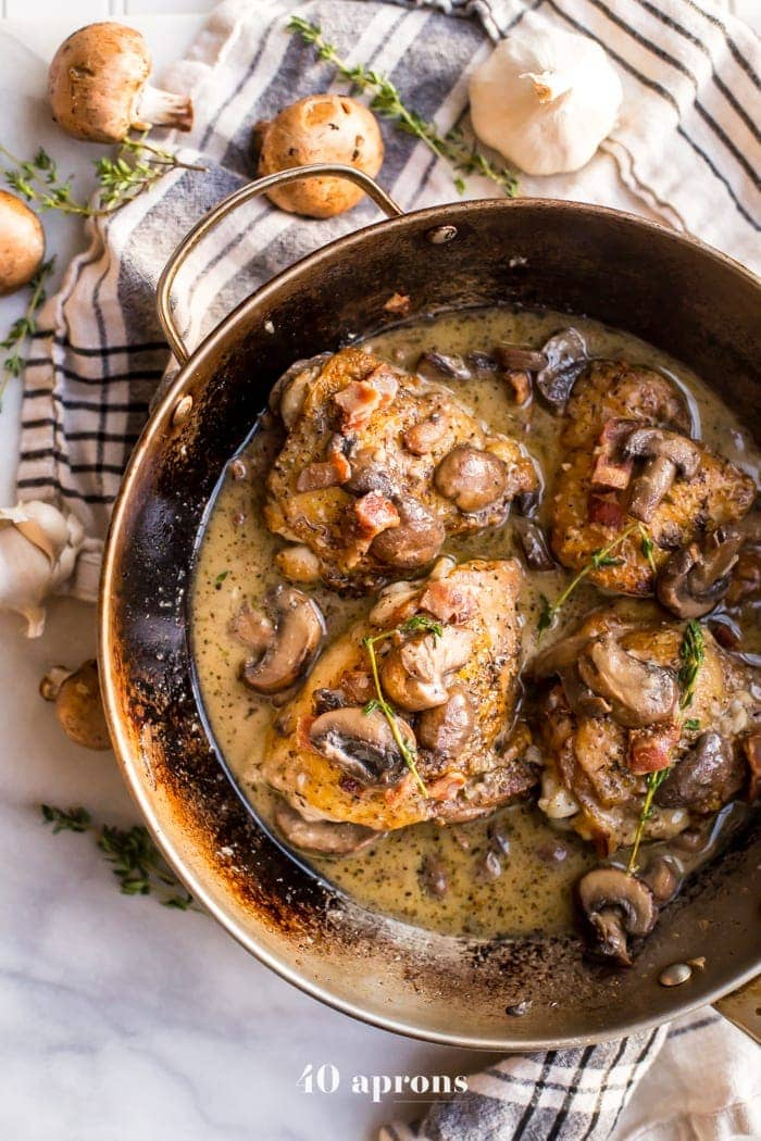 These creamy Whole30 bacon mushroom chicken thighs are absolutely delicious. Crispy skin and tender inside, chicken thighs are coated in a creamy sauce with salty, crispy bacon, earthy mushrooms, and fresh thyme. These creamy Whole30 bacon mushroom chicken thighs might become your favorite quick Whole30 dinner recipe! But for a quick Whole30 dinner recipe, these creamy Whole30 bacon mushroom chicken thighs are totally dinner party worthy.