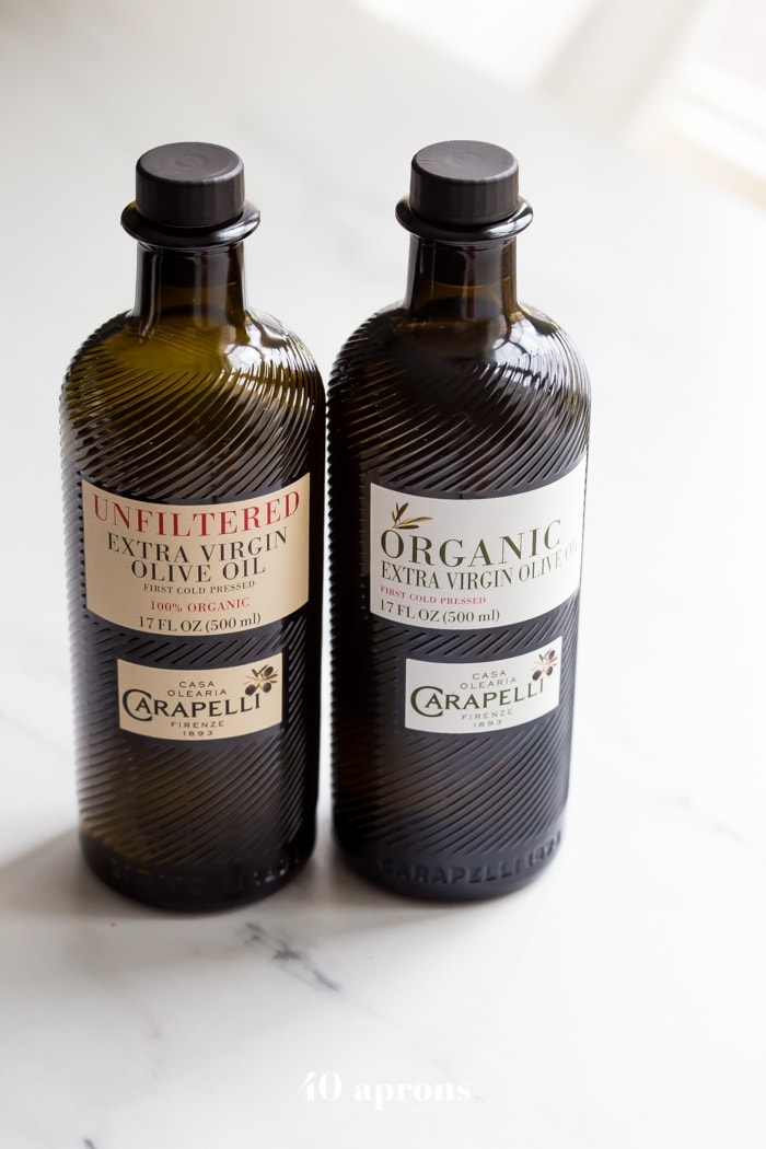 two bottles of Carapelli olive oil -one organic, one unfiltered