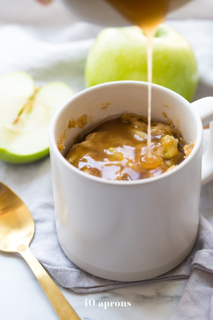 This paleo caramel apple microwave cake is indescribably good, with a moist cinnamon-spiced cake, tender green apples, and a 2-minute caramel sauce to top it all. I bet you'll make this paleo caramel apple microwave cake all the time, since it only take a few minutes to stir together and two minutes in the microwave to cook! This paleo caramel apple microwave cake is theperfectpaleo microwave dessert. I'm obsessed!