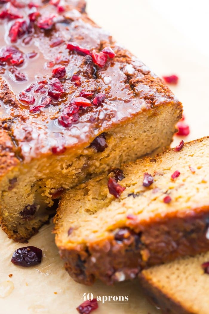 This paleo cranberry orange pound cake is such a wonderful paleo fall recipe! With fresh orange flavor and sweet-tart dried cranberries, this paleo cranberry orange pound cake is tender, moist, and full of flavor. This paleo cranberry orange pound cake takes full advantage of such a fantastic flavor combo and uses all healthier ingredients to make a lovely paleo fall recipe! Plus, details on how to put together the best pregnancy care package (not for me!).