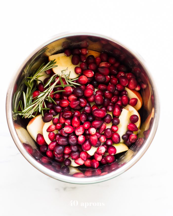 This Instant Pot Whole30 cranberry sauce with apples and rosemary is the perfect Whole30 cranberry sauce: sweet and tart with no added sweeteners at all! It's the perfect addition to any Whole30 Thanksgiving table and goes beautifully with my Whole30 green bean casserole. You'll love this Instant Pot Whole30 cranberry sauce with apples and rosemary because it's so easy and quick yet gourmet!