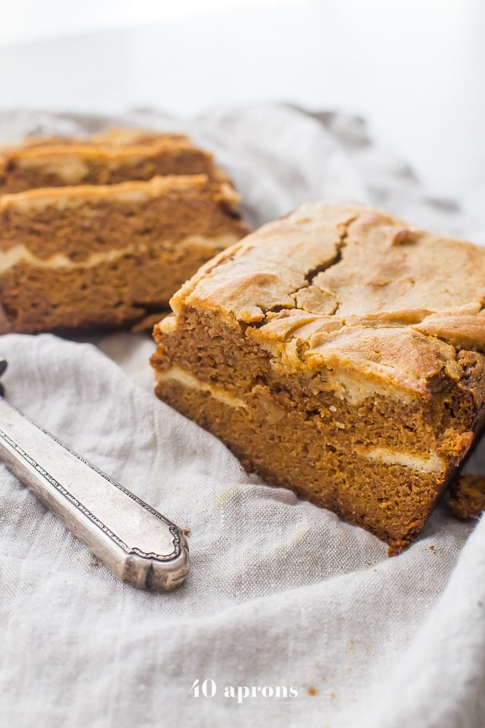 This paleo cheesecake stuffed pumpkin bread is a tender and spiced paleo pumpkin bread, layered with a sweet, dairy-free cream cheese filling. One of my very favorite paleo fall recipes, this paleo cheesecake stuffed pumpkin bread is an absolute must-make this fall! Guarantee it will become one of your favorite paleo fall recipes, too!