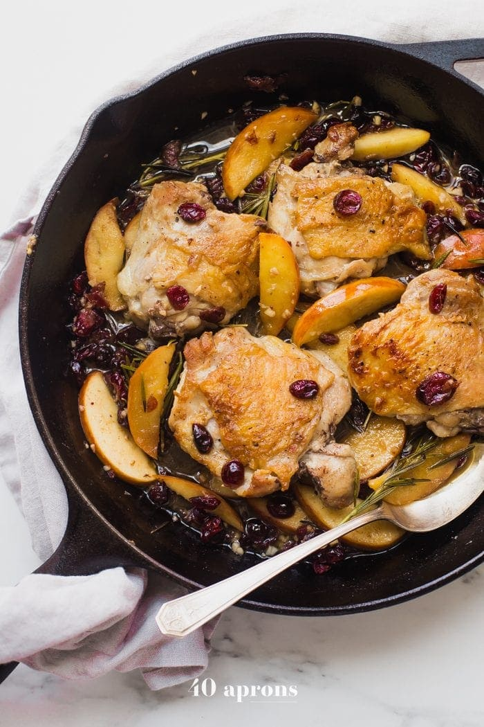 These paleo cranberry apple chicken thighs with rosemary are such a delicious paleo fall recipe. With organic cranberry juice and dried cranberries, these paleo cranberry apple chicken thighs are an easy and quick paleo dinner that's elegant enough for company.