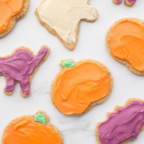 These paleo Halloween cookies are almost too cute to handle. Tender and soft with a paleo buttercream-style frosting, these paleo Halloween cookies are a must for this holiday! Whether you cut them into pumpkins, ghosts, or bats (or maybe zombies, anyone?), these paleo Halloween cookies are a healthier way to enjoy the classic holiday treat. No tricks here!