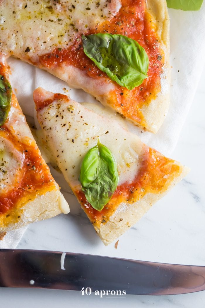 This perfect paleo pizza recipe is exactly that: the perfect paleo pizza recipe! Made with a yeasted cassava flour pizza crust, it's tender but crisp on the outside, layered with a paleo mozzarella (totally dairy-free!) and fresh basil. This perfect paleo pizza recipe and the yeasted cassava flour pizza crust (and the paleo mozzarella, for that matter!) are actually quite easy, too! You'll be shocked at how similar it tastes toreal Italian pizza.