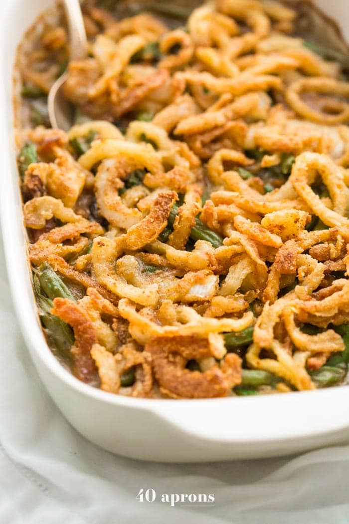 This Whole30 green bean casserole is just like the classic Thanksgiving dish: tender green beans in a rich cream of mushroom sauce, topped with fried onion straws. This Whole30 green bean casserole (also a paleo green bean casserole, of course!) is an absolute must for the Whole30 Thanksgiving table. And to be honest, this paleo green bean casserole tastes even better than the classic version!