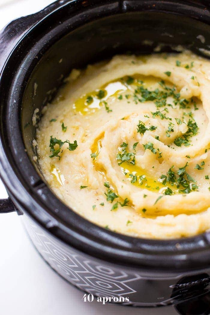 These Whole30 Crockpot mashed potatoes are so easy and creamy. Lactose-free and with a vegan or dairy-free option, these Whole30 Crockpot mashed potatoes are absolutely perfect for any Whole30 Thanksgiving or vegan Thanksgiving table, since they cook while you work on the rest of dinner! Rich and garlicky, these Whole30 Crockpot mashed potatoes will totally become a Whole30 Thanksgiving or vegan Thanksgiving tradition.